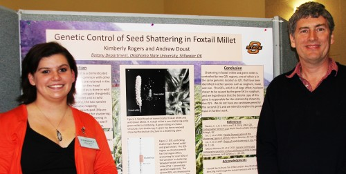 Kimberly Rogers with her mentor, Andrew Doust, and her research project display at Oklahoma State University's Student Union Ballroom at end of the year presentations.
